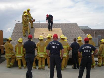 Fire Trainees with Roof Ladder Prop