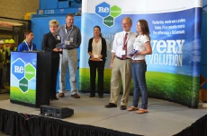Presenting awards to local businesses for their recycling programs.