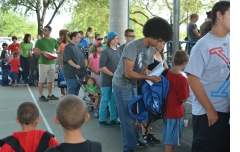 Tucsonans waiting in line for free school supplies.