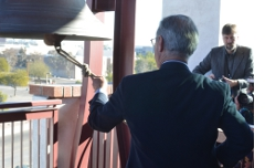 Ringing the bell at Fire Central in remembrance of the victims of the January 8 shooting.